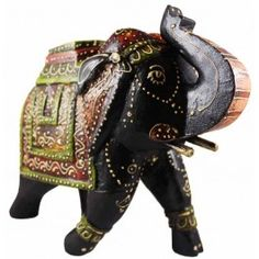 Here we see an elegant elephant figure hand carved from mango wood and ornamented in the classic Indian style. Bold red, white and black painting, with green and gold accents on the polished wood all come together to make one of the most charming figures imaginable. This would be lovely as a centerpiece or sculpture on display, and is a perfect example of regal artistry. Elephants with its trunk up is a source of good luck and good fortune for anyone who owns such a collectible.