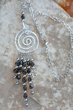 This stylish necklace is about psychic protection, grounding & well-being! Smoky Quartz is the premier grounding & anchoring stone, & is highly protective especially during psychic/healing work. It transmutes negative energies, grounding them down into the Earth. It also brings happiness & will help you to retain a good sense of humor. A powerful stone to use for physical healing, it has the added benefit of amplifying the healing properties of other stones.