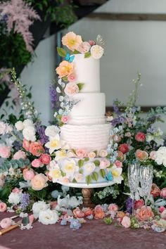 """From the editorial """"Every Inch Of This Texas Wedding Is Filled With Fantastic Flowers."""" This sugar flower cake has blown us away! Just wait until you see the rest of this bride and groom's reception details!  Photography: @joshplusdana  #weddingcake #weddingcakeinspo #floralcake #butterflycake #flowerweddingcake"""