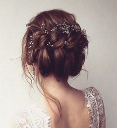 messy twisted updo wedding hairstyle with dainty hair accessories via ulyana aster