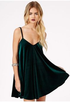 Ines Velvet Strappy Swing Dress In Deep Green// green velvet jeans // black boots & bag // gold jewelry