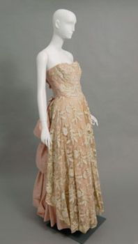 Women's evening ensemble (dress and slip), designed by Carrie Munn, c. 1950's. Pink silk faille, off-white silk appliquéd and embroidered net, off-white silk faille.