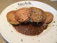 Delicious fried green tomatoes and tasso ham gravy at a Knoxville TN restaurant.