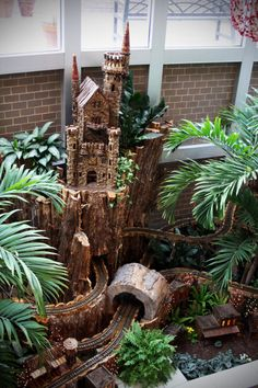 Fairy Garden - How cute would this be with a little steam train running through it on the tracks? ~K
