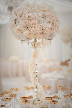 pastel wedding floral decorations. Beautiful centerpieces - love the gold tipped glasses as well