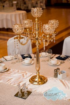 gold candelabra with arms