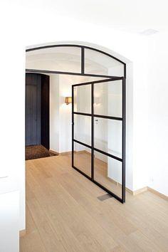 Metal-framed door by ODS Jansen | Archello