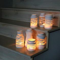 DIY Mason Jar lights - just wrap a yarn design around the jar before painting . so, once you add a candle or solar bulb, the light will shine through! Can also put stickers or rubber bands around the jar before painting to make designs! Pot Mason Diy, Diy Mason Jar Lights, Mason Jar Lighting, Mason Jar Crafts, Diy Jars, Reuse Jars, Solar Mason Jars, Mason Jar Lanterns, Mason Jars