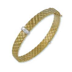 This beautiful bracelet comes in silver also.  http://www.jgabrieldesigns.com/basket-weave-gold-bracelet-with-pave/