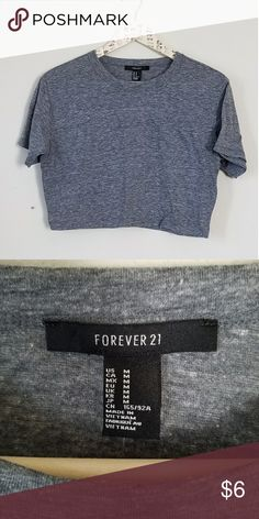 Forever 21 Grey crop top Grey t-shirt crop top, never worn. It great condition!  *No trades  *I am happy to answer questions about fit, and take more measurements if needed  *To avoid scammers I will only sell to people that have items on their closet or have reviewed other items. Forever 21 Tops Crop Tops