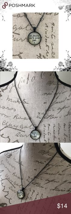 """'My Story Isn't Over Yet' Necklace Glass Pendant on a black chain. Lobster clasp closure. Approx 17"""" in length. Bundle for discounts! Thank you for shopping my closet! Jewelry Necklaces"""