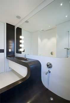 CASA-O, Roma, 2010 Gorgeous, looks almost as if the sink is being poured into the bathtub! Love it