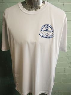 Sports round neck t-shirts printed for the Gentleman's Football club. With custom printed logo on the front in blue and number design in the back with custom names for the players.