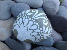 White Zen series ~ Joyful. Painted rock (sea stone) from Cape Cod First snowfall in winter Billowy clouds on a summer day Swans on a