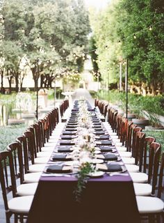 Long tables make a more intimate dinner setting   At Marie Gabrielle #dweddings #tablescapes #fallwedding #outdoorwedding