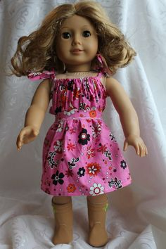 An easy, cute, free American Girl Doll dress pattern.  It took only a couple of hours.  http://blogging-mama.com/kids/a-midwest-springtime-activity/, #Americangirldollpattern, #sewingwithgirls