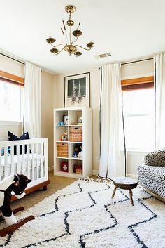 Ikea's Expedit bookshelves (but under the windows) ; rug; crib