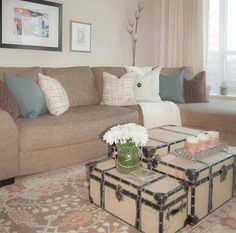 Working with a modest budget, we got creative and fashioned a coffee table out of 3 trunks of various sizes.  In a small space, this solution also added much needed storage.