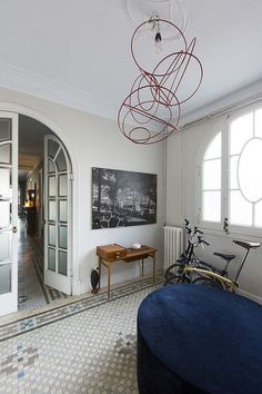 Arched french doors with frosted glass panels.  Interior design by Georg Kayser | Lonny November 2013