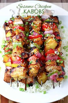 Grilled Sesame Chicken Kabobs Recipe: Tender chunks of chicken are grilled on skewers with peppers and pineapple, and basted with a sweet and spicy glaze. Chicken Kabob Recipes, Chicken Kabobs, Grilling Recipes, Cooking Recipes, Bbq Recipes Kebabs, Barbecue Recipes, Grilling Tips, Popular Recipes, My Recipes
