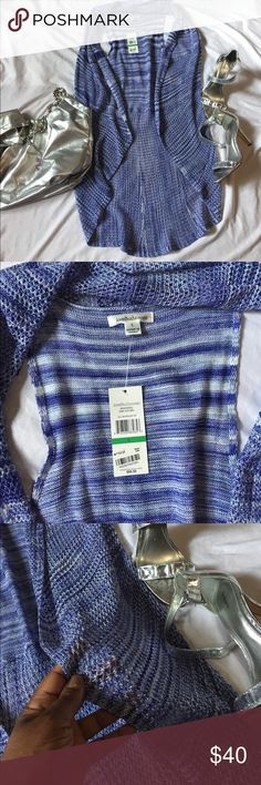 Johnpaul Richard knit high low vest Lovely John Paul Richard high low vest never worn with tags.Blue and white in great condition.Made from 100 percent acrylic. john paul richard Tops Blouses