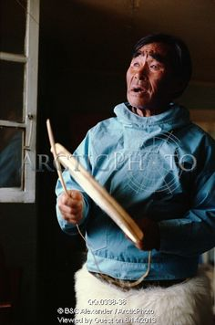 Image of masautsiaq eipe an elderly inuk drum sings using a traditional drum. only the rim is hit. qaanaaq, n.w. greenland. by ArcticPhoto