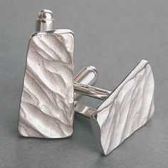 Chunky, tactile contemporary cufflinks in British hall-marked solid silver, in a design unique to Latham and Neve.  Inspired by wind over sand and the romance of the desert, soft, asymmetrical, deeply textural shapes to create these highly individual, modern, sculptural items of men's jewellery.