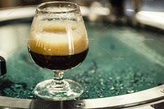 Glass of stout at the brewery by Hidden Hallow  on @creativemarket