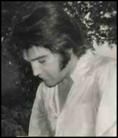 rare candid: Elvis 1969... Very sweet, contemplative expression