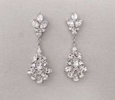 Chandelier bridal earrings in a dramatic teardrop shape. Adds style to all wedding dress silhouettes.