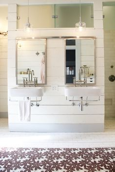LOVE. Two sinks and mirrors on a short wall with clerestory window above and doorways on each side that open to the walk-in shower