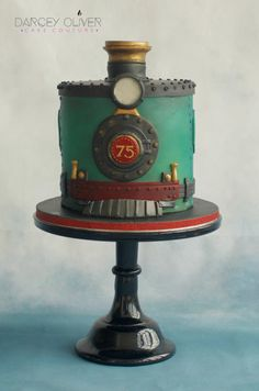 All aboard! This cake was designed to celebrate a 75th birthday of a life long steam train enthusiast. The client didn't want a fully carved train cake but did want a train represented in some way on the cake. I decided to take iconic elements...