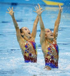 Stylish Synchronised Swimmers - Synch. Swimming Slideshows | Hyunha Park and Hyunsun Park (KOR) perform their technical routine during duet qualifications.  (Photo: Rob Schumacher - USA TODAY / US Presswire) #NBCOlympics