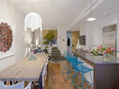 eclectic-kitchen-wooden-dining-room-table-blue-iron-barstools
