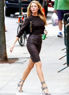 Fantastic form: Blake Lively showcased her trim figure in a brown leather pencil skirt and matching cropped jumper