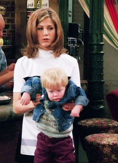 """Friends - Ross: """"Just hold him like you would hold a football."""" Rachel: """"This IS how I would hold a football."""""""