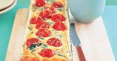 This moist cherry tomato and spinach quiche is the perfect light lunch on a hot Summer's day.