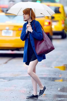 Emma Stone's Rainy-Day Outfit Is Simple, But Perfect #refinery29 http://www.refinery29.com/2014/09/74635/emma-stone-max-mara-coat-outfit#slide1 Emma's outfit is a ray of sunshine on an otherwise gloomy, overcast day.
