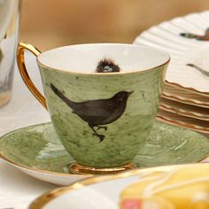 vintage bird design tea cup and saucer by melody rose | notonthehighstreet.com