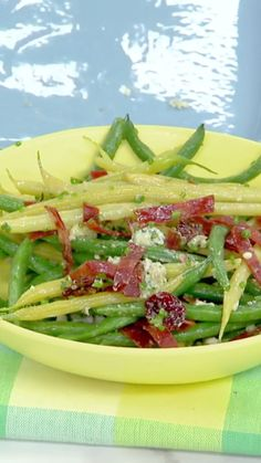 Katie tosses her Green and Wax Bean Salad with a freshly-made vinaigrette!