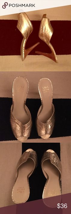 Gold Saks Fifth Avenue high heeled mules Gold crocodile embossed leather 3 1/2 inch mules.  Visible portion and actual heels in great condition bottoms are scuffed.  Please see picture for clarification.  Saks Fifth Avenue brand - sexy & comfortable! Size 9 Saks Fifth Avenue Shoes Mules & Clogs