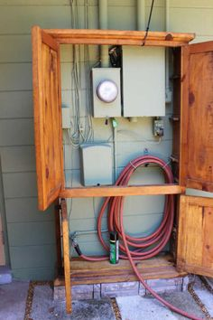 Hide Your Unsightly Outdoor Fixtures With a Repurposed Armoire