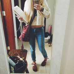 clothes: jeans with a white sweater and maroon purse