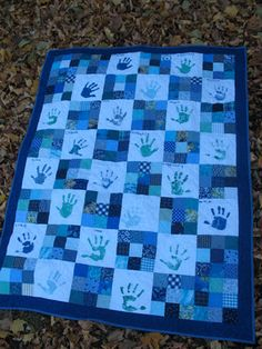 LOVE the handprint idea and after making two quilts for family I want one of my own!