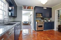 Paint your kitchen cabinets instead of buying new ones to get a fresh look on a budget.(Photo: Houlihan Lawrence Inc.)