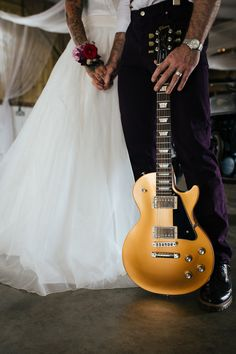 Rock and roll bride and groom with Les Paul guitar
