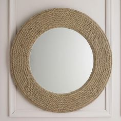 """Nautical Sisal Rope Mirror nformal styling of this mirror features sisal rope wrapped around a center mirror for a perfect casual seaside style. (36""""Round)."""