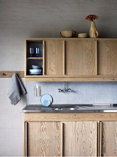 Kitchen cabinets with sliding doors in a scandinavian kitchen by Irina Graewe http://www.irinagraewe.de