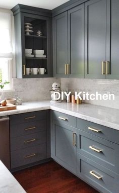 Remodeling Kitchen Cabinets dark gray cabinets and brass hardware Uplifting Kitchen Remodeling Choosing Your New Kitchen Cabinets Ideas. Delightful Kitchen Remodeling Choosing Your New Kitchen Cabinets Ideas. Large Kitchen Cabinets, Kitchen Cabinet Colors, Kitchen Redo, Home Decor Kitchen, Interior Design Kitchen, Island Kitchen, Kitchen Walls, Grey Painted Kitchen Cabinets, Kitchen Designs
