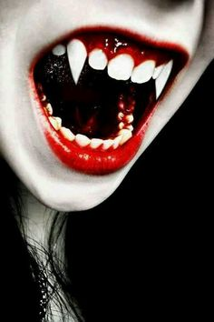 Long classic vampire fangs, though they seem to be awkwardly angled. The color interaction between the blood and the lower teeth is fascinating. Vampire Love, Vampire Girls, Vampire Art, Vampire Diaries, Dracula, Vampiro Real, Zombies, The Dark Side, Vampire Pictures